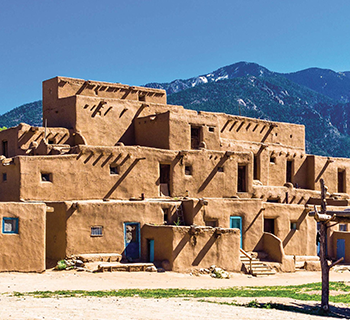 Taos Pueblo World Heritage Site with mountains behind