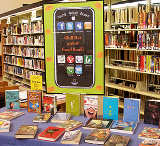 Young adult book table with sign